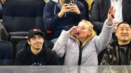 'Send it for the Starks': Game of Thrones star Sophie Turner downs glass of wine at NHL game (VIDEO)
